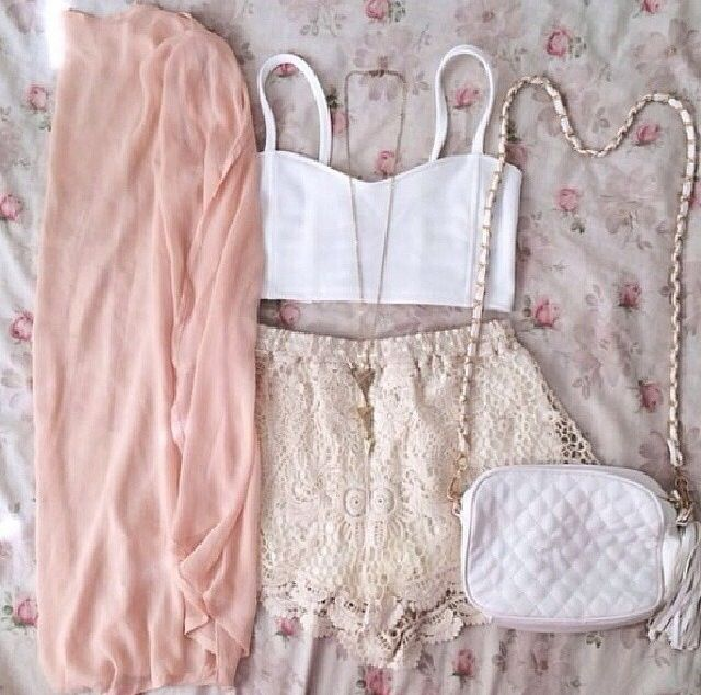 White shirt with baige shorts, pink jacket and white cross body purse