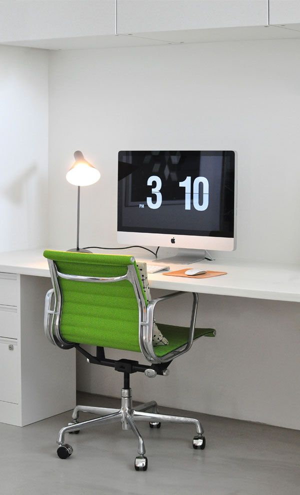 Bright modern home office love how the green chair offsets the stark white space