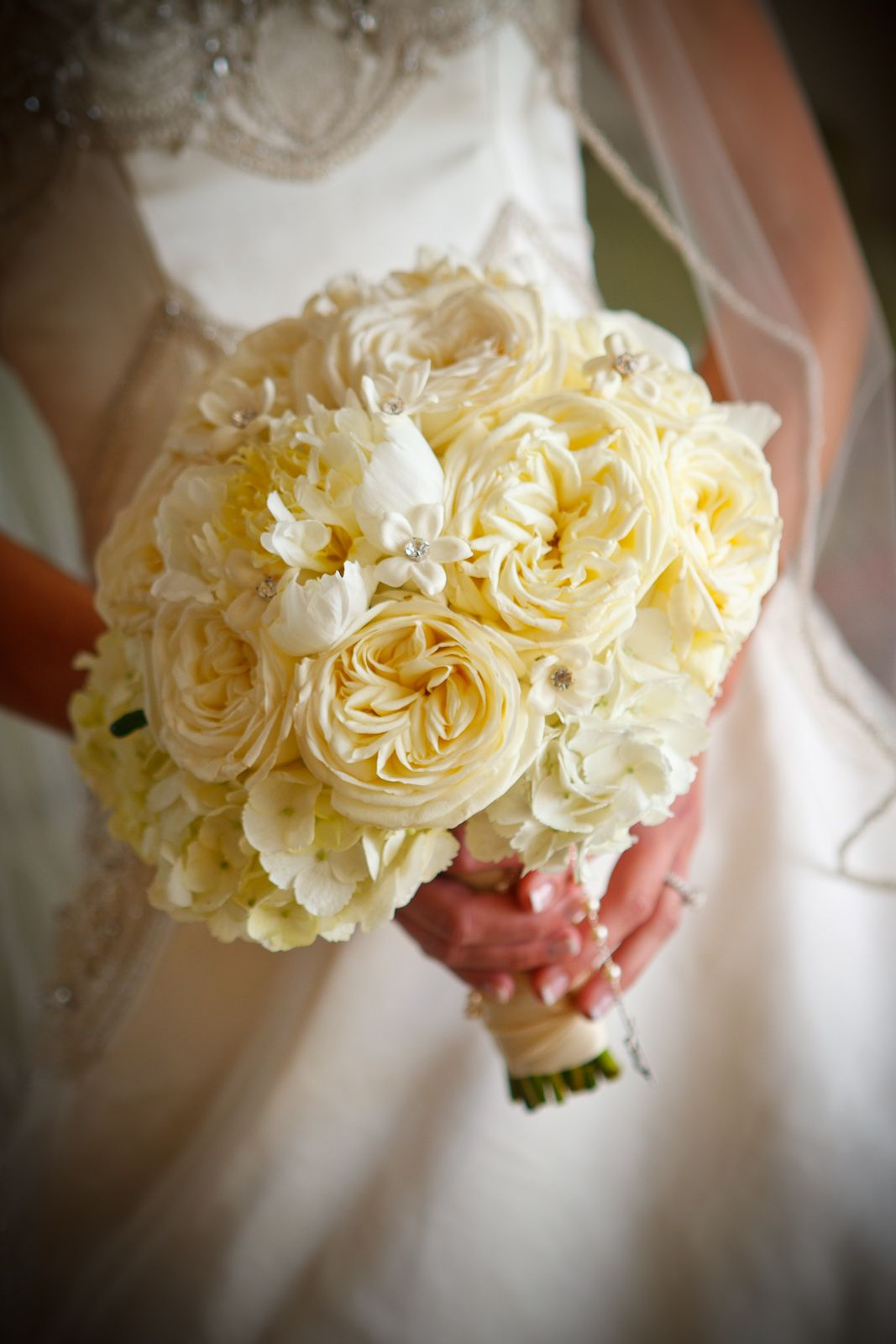 white garden roses peonies hydrangeas and stephanotis bridal bouquet by botanica wedding