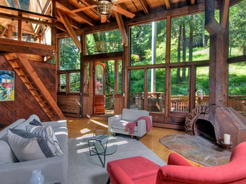 photo of living room during the day inside of tree house in the forest - Treehouse Masters Tree Houses Inside