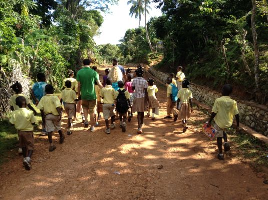 Walking with school children on a mountain road above Jeremie - http://robinfritz.wordpress.com/2013/01/11/missionary-style-an-idiots-guide-to-doing-good-works-in-haiti-part-ii/