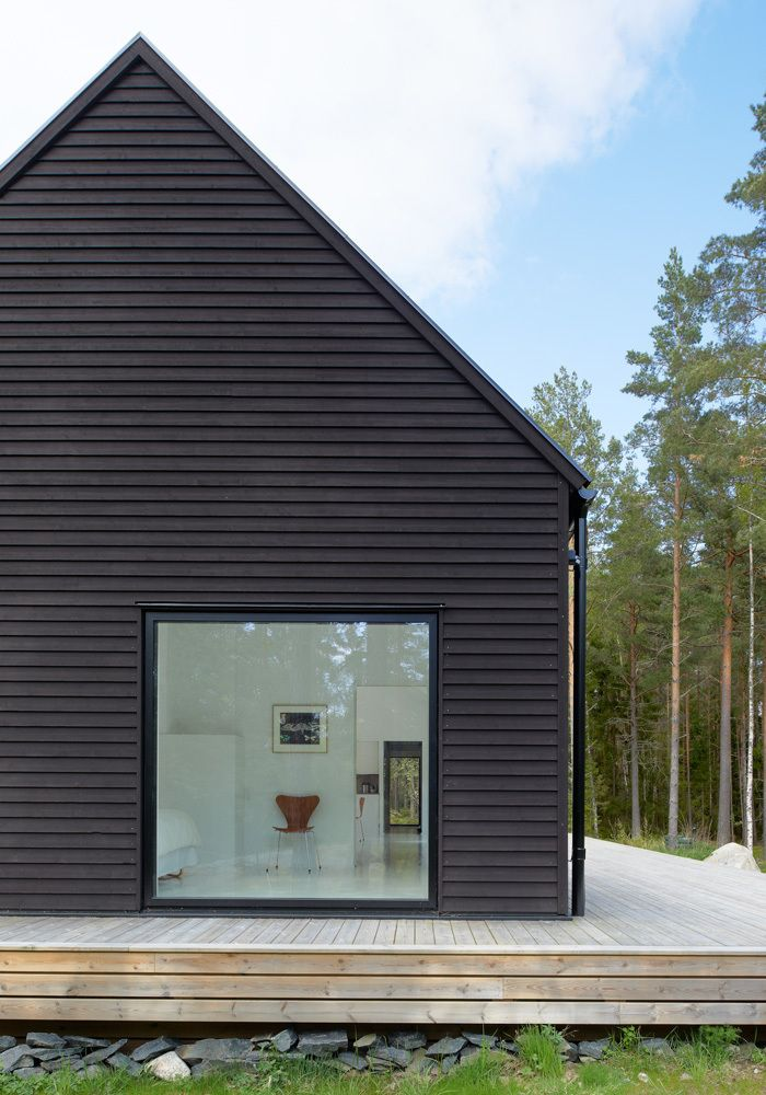 "Villa Wallin by Erik Andersson Architects, Yxlan, Stockholm archepelago, Sweden ""The house is clad with horizontal pine panels, painted black with Falu Rödfärg– a traditional Swedish paint that can be traced right back to the 16th century – while the roof is covered with tar felt."""