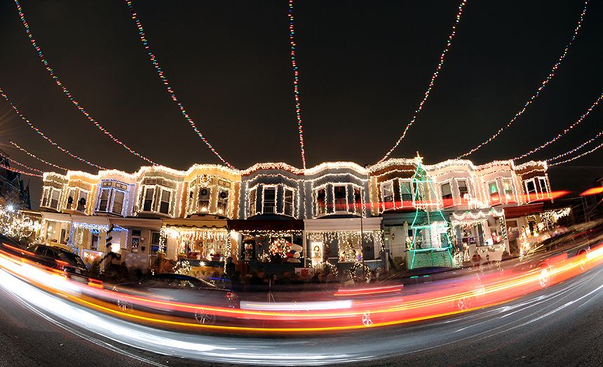 cars trickle down the 700 block of 34th street in baltimore s - Hampden Christmas Lights