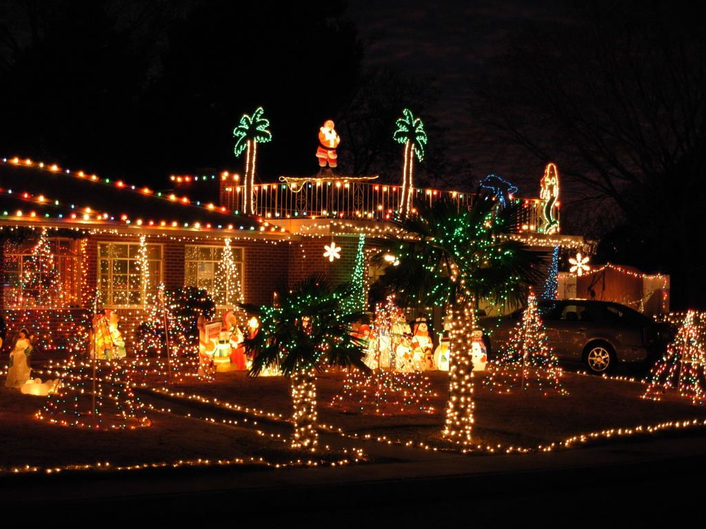 Albuquerque Ne Heights Home Always Lights Up Its Windmill Palm To Go With The Surfing Santa D Christmas House Lights Outdoor Christmas Decorations Xmas Lights