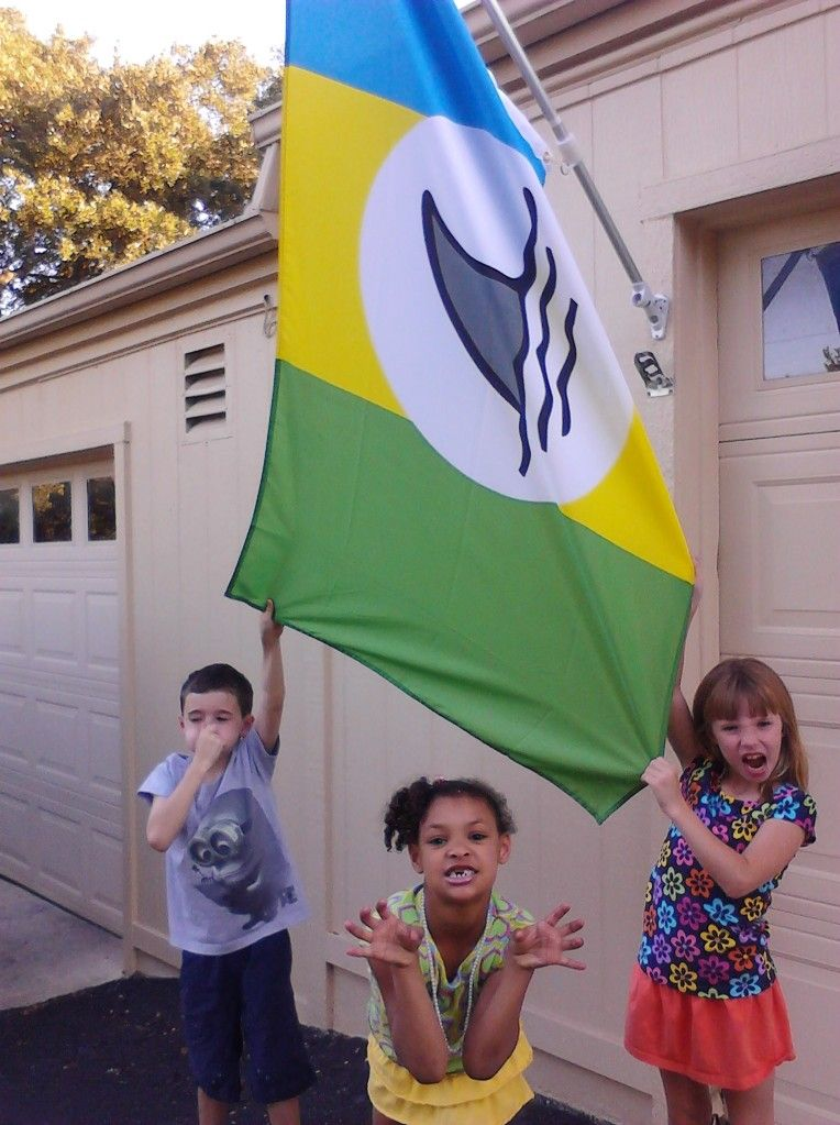 Beck, Zariah and Tiger making fun of the neighbors flag. Spring 2012