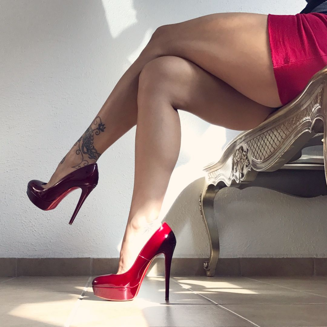 Sexy woman in short red dress black high heels