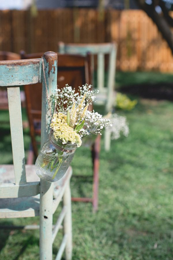 Hanging mason jars with yellow flowers and baby's breath ...