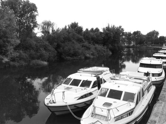 Barche sullo Stella, Precenicco. Boats on river Stella in Precenicco, near Udine, Italy.