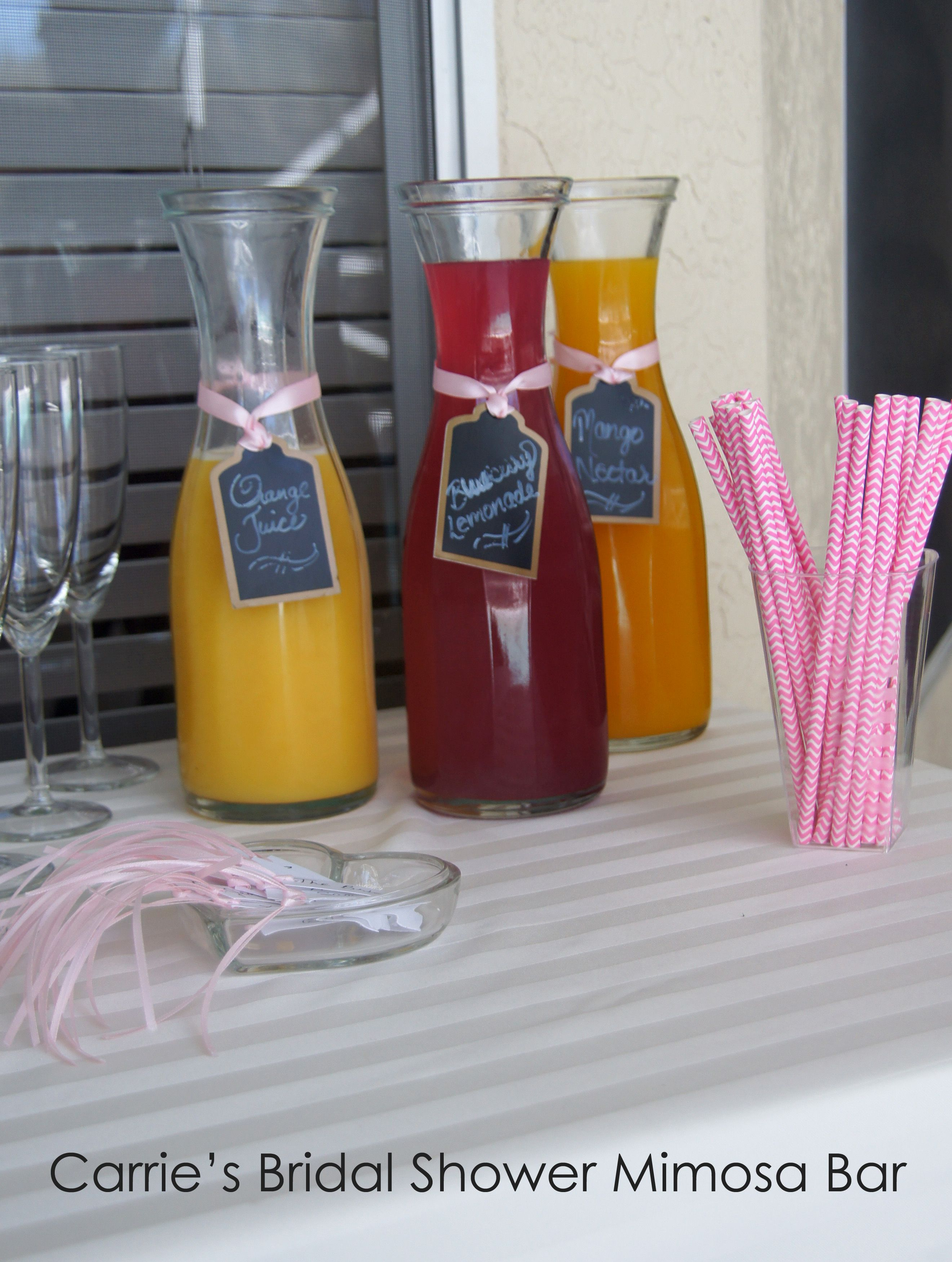 Mimosa Bar - Fruit Juices in Ikea carafe, striped straws, champagne glass markers for Bridal Shower