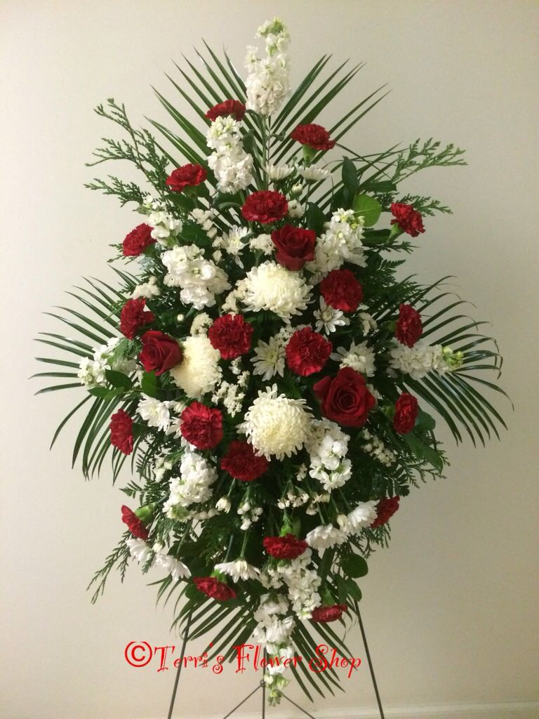 Red And White Funeral Easel By Terri S Flower Shop Funeral Floral Arrangements Funeral Floral Flower Shop Design
