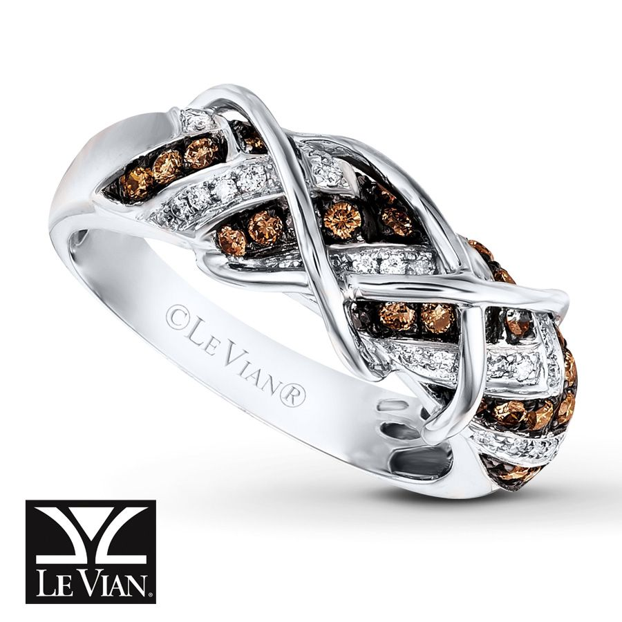 Alternating diagonal rows of Chocolate Diamonds® and Vanilla Diamonds® are topped by swirls of 14K Vanilla Gold® in this intriguing ring from Le Vian®. The ring has a total diamond weight of 1/2 carat. Le Vian®. Discover the Legend. Diamond Total Carat Weight may range from .45 - .57 carats.