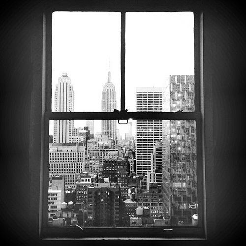 A window view from Rockefeller Plaza.  #window #skyline #skyscrapers #rockefeller #rockefellercenter #rockefellerplaza #ny #newyork #manhattan #city #bw #blackandwhite #black #white #instagood #tweegram #photooftheday #instamood #iphonesia #tbt #igers #pi
