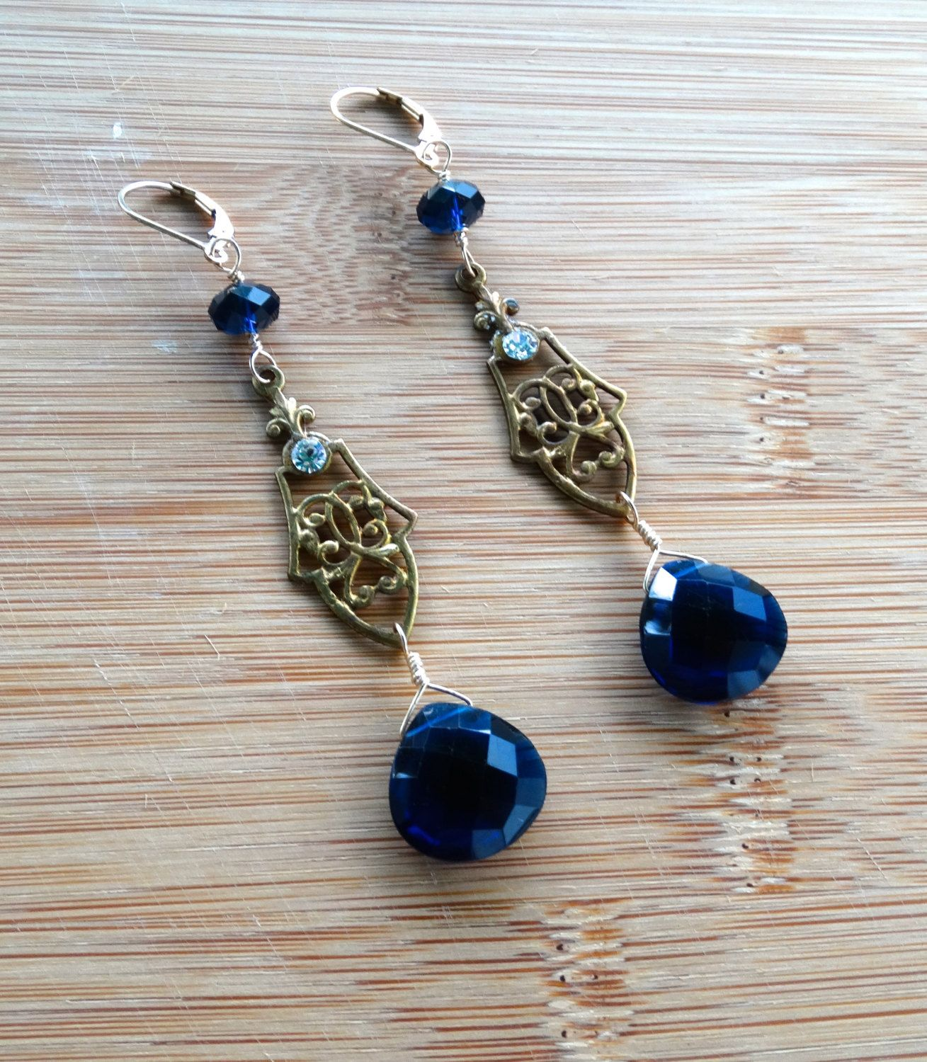Deep blue Swarovski roundels, vintage brass stamping with handset rhinestone, cobalt blue hydro quartz, 14k goldfilled hooks and wire by ChrisAllenJewelry on Etsy