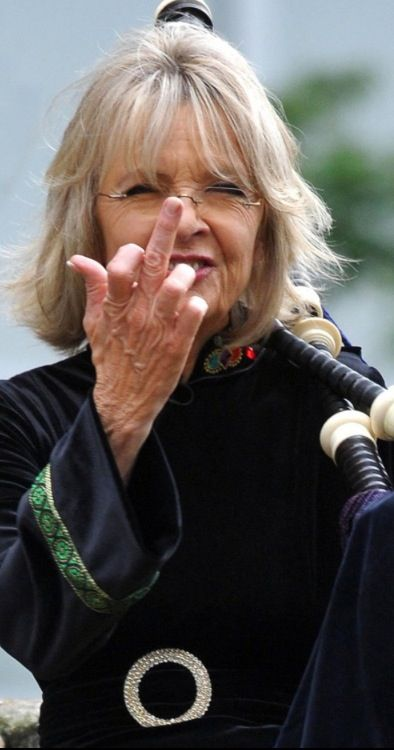 Diane Keaton flips you off while holding bagpipes. Fuck yeah