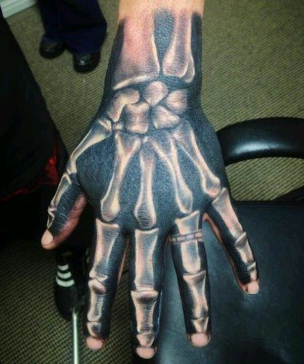 92e9eb1cf Done by Tommy Montoya. Skeleton, bones, black and white, shading. Hand  tattoo.