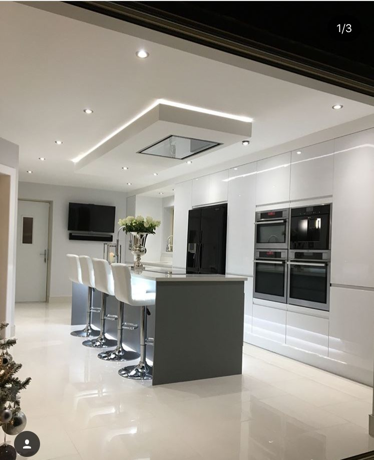 Modern white gloss integrated handle kitchen with 18mm Corian wrap - k chenzeile l form