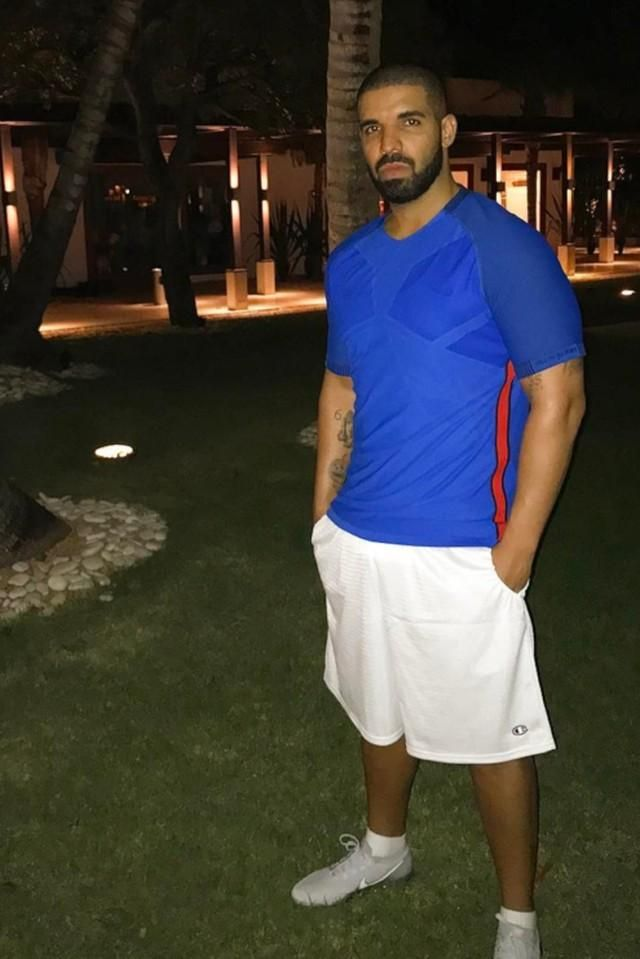 0a0ab15f Drake outside in a Champion shorts and Nike Air VaporMax sneakers ...
