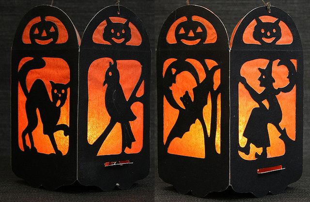 1920's Halloween Lantern... THESE SHOULD BE PRETTY EASY TO MAKE... BLACK PAPER CUT OUTS WITH ORANGE CREPE PAPER BEHIND THE WINDOW