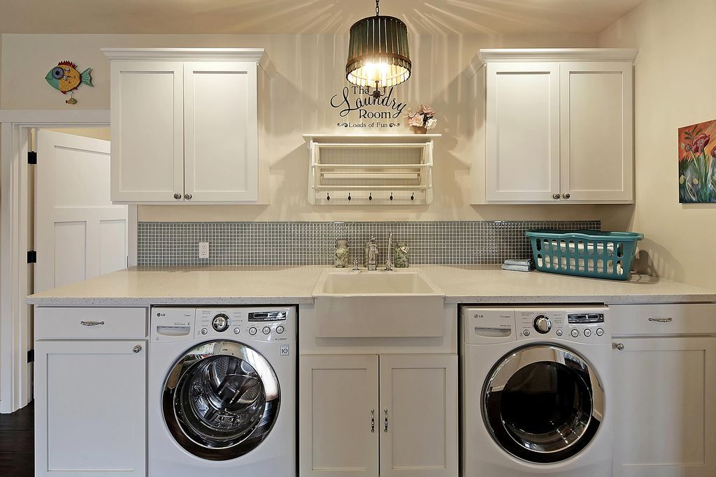 Traditional Laundry Room With High Ceiling Hardwood Floors