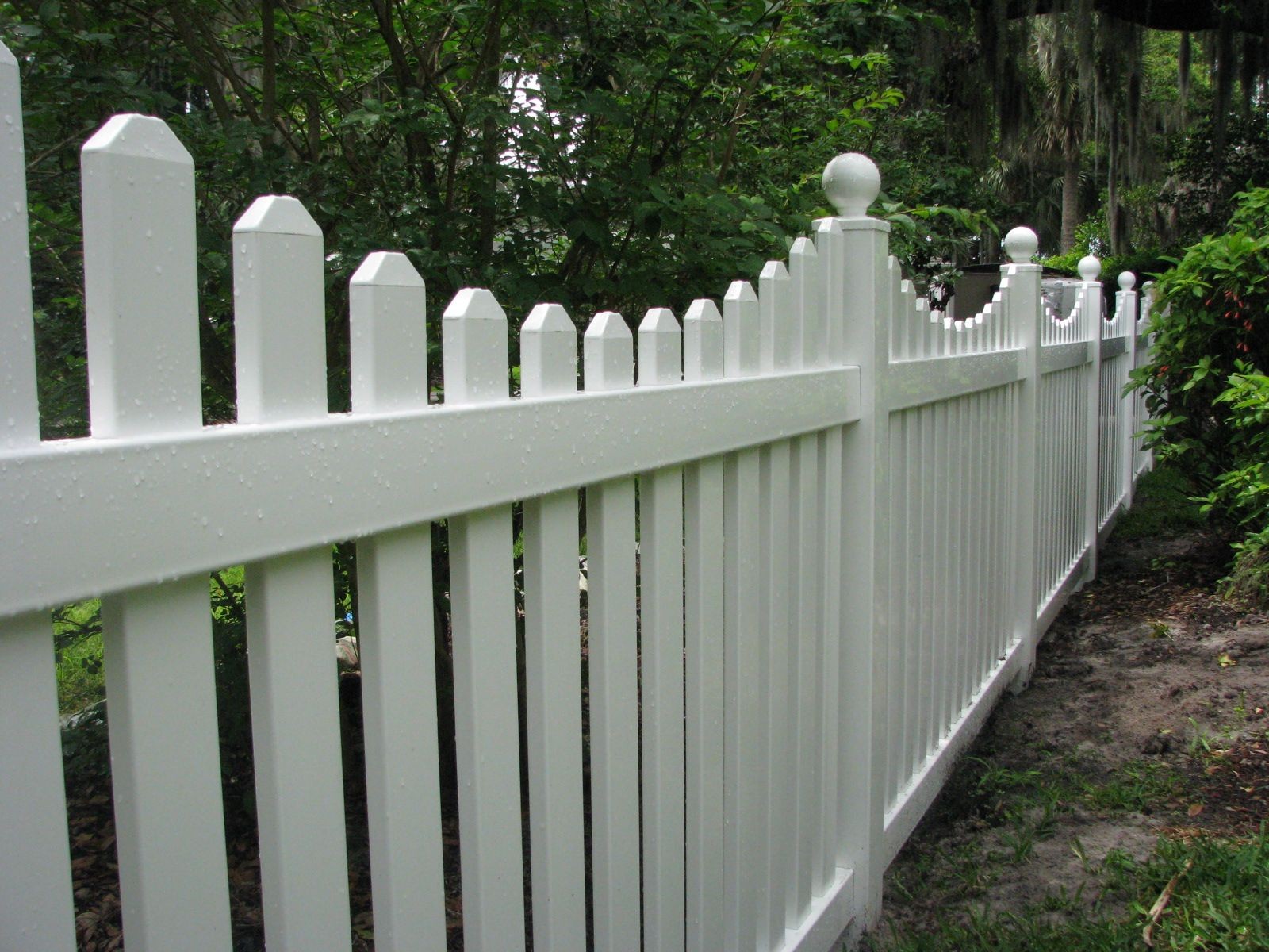 White vinyl picket fence by Mossy Oak Fence pany