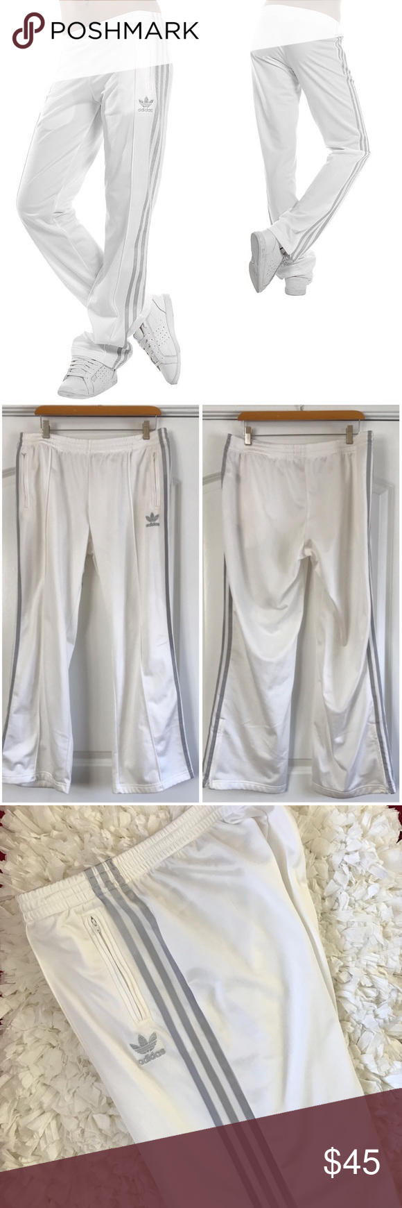 "Adidas Firebird Track Pant in White and Silver Adidas original firebird track pant in running white with metallic stripe. Zip pockets and fleece lining. In great condition. Smudge on the bottom of the cuff. Pic included. Can be cleaned off. Length 39"", inseam 31"", across waist 18"" Adidas Pants Track Pants & Joggers"