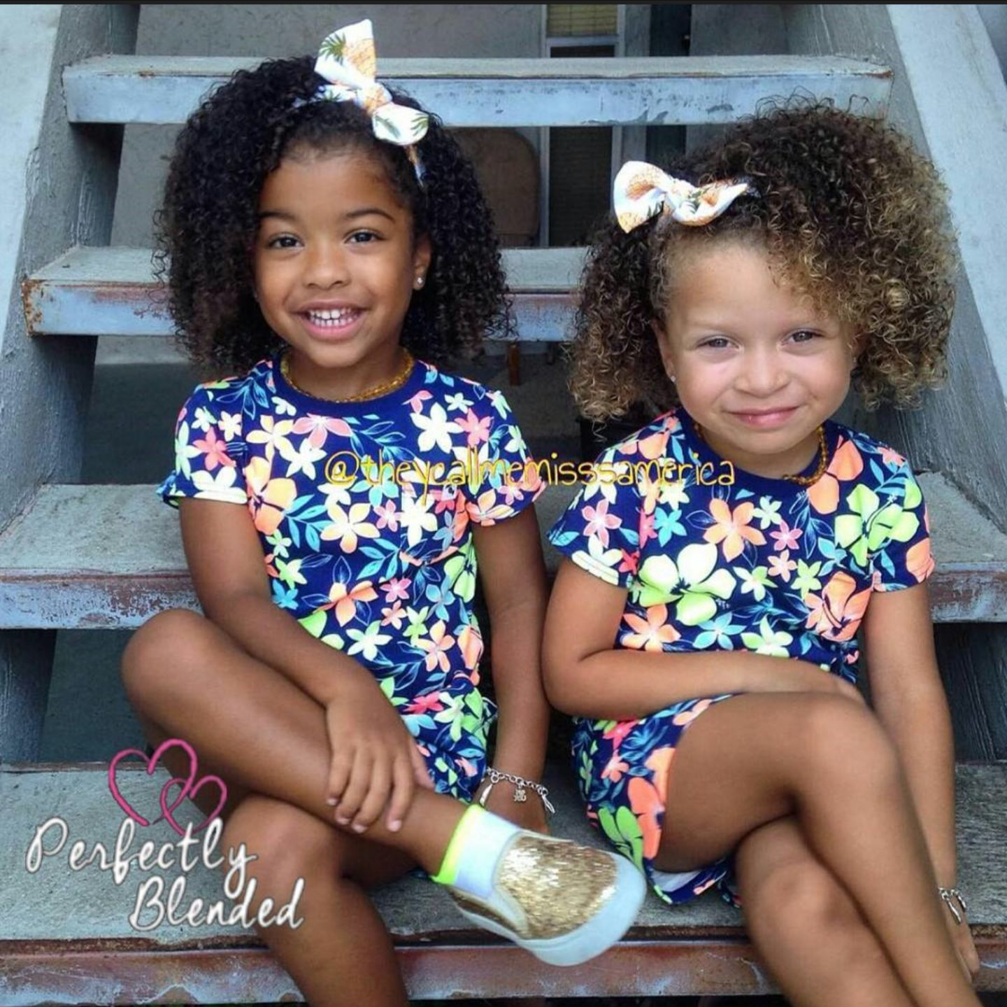 Caucasian and african american 3 year old twins