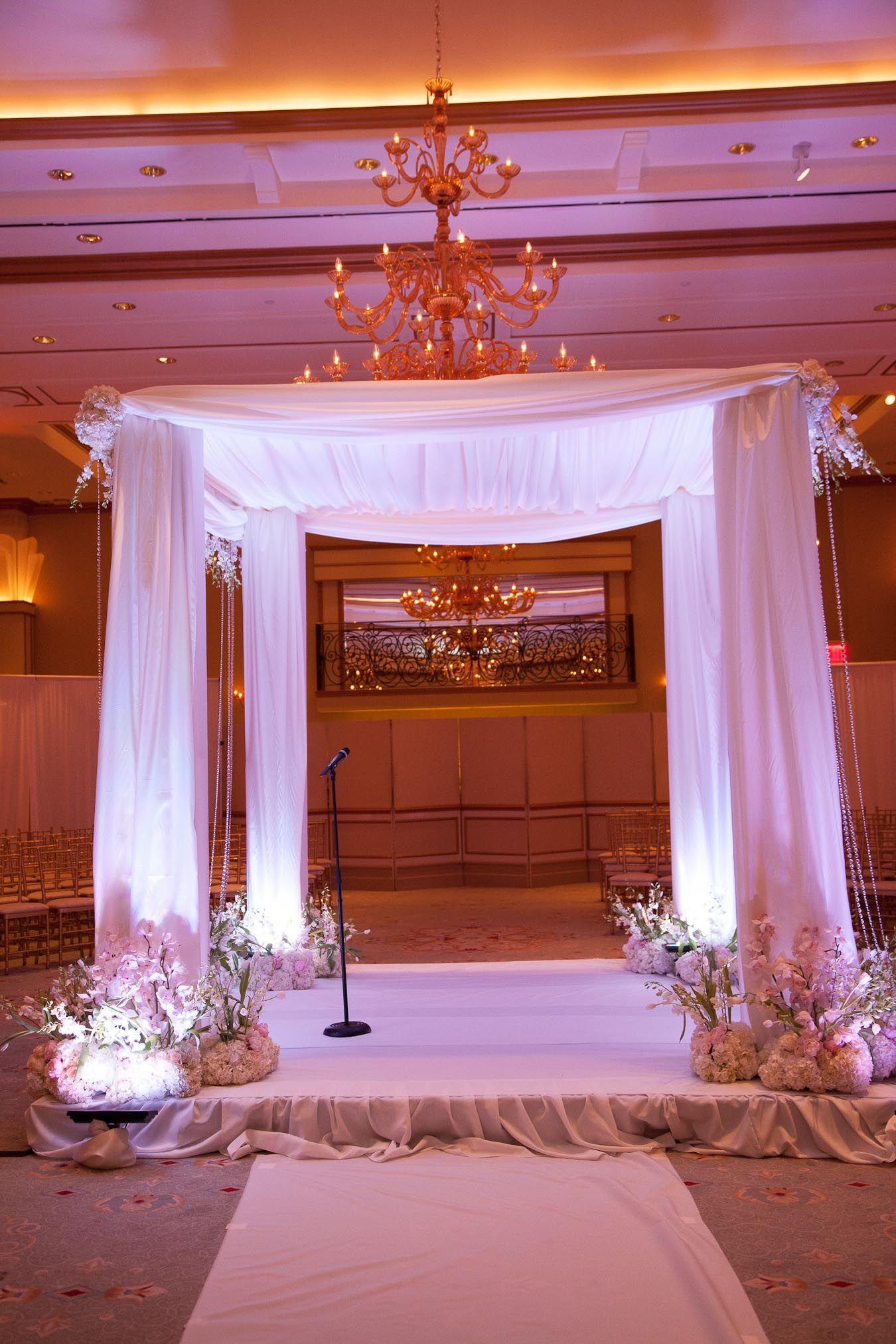A beautiful uplit chuppa at The Grove a luxury wedding