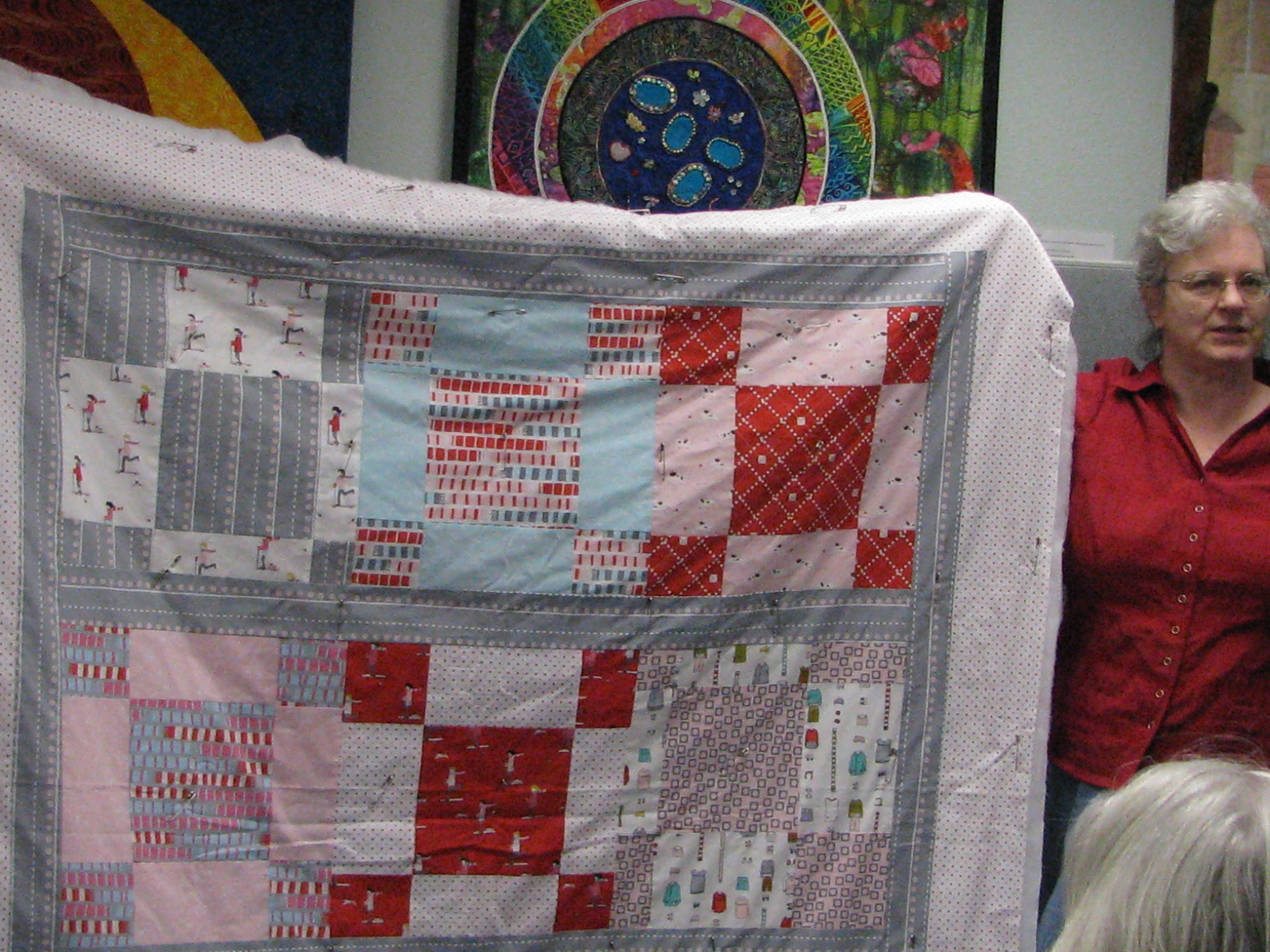love the patchwork and the way the colors were combined.  this was not an easy fabric combo to use