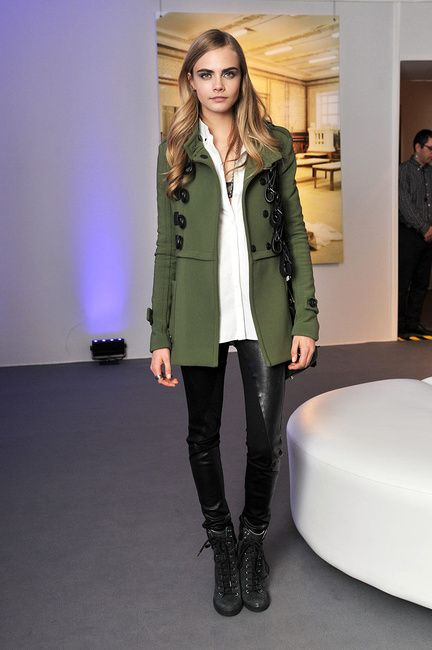 Cara Delevingne in Burberry Prorsum Coat with leather leggings and See by Chloe wedge sneakers
