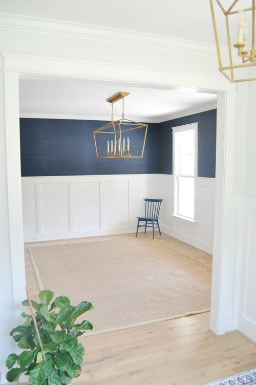 Dining grasscloth wallpaper and arch moulding + black door