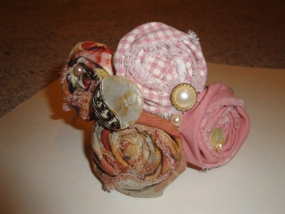 Lovely pink and brown handrolled fabric rosette cluster headband! Comes on a tan satin covered hard headband that fits all ages and has several unique pearl and gold shell buttons so you know it's one-of-a-kind!!