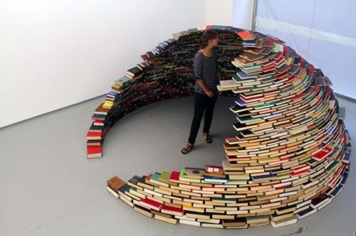 """book igloo (in progress): """"Miler Lagos's installation at the MagnanMetz Gallery in New York City is entitled simply """"Home"""". After he finished it, the dome was completely enclosed and self-supporting. Just imagine if you had one of these, consisting entirely of the books that you have read over the course of your life."""""""
