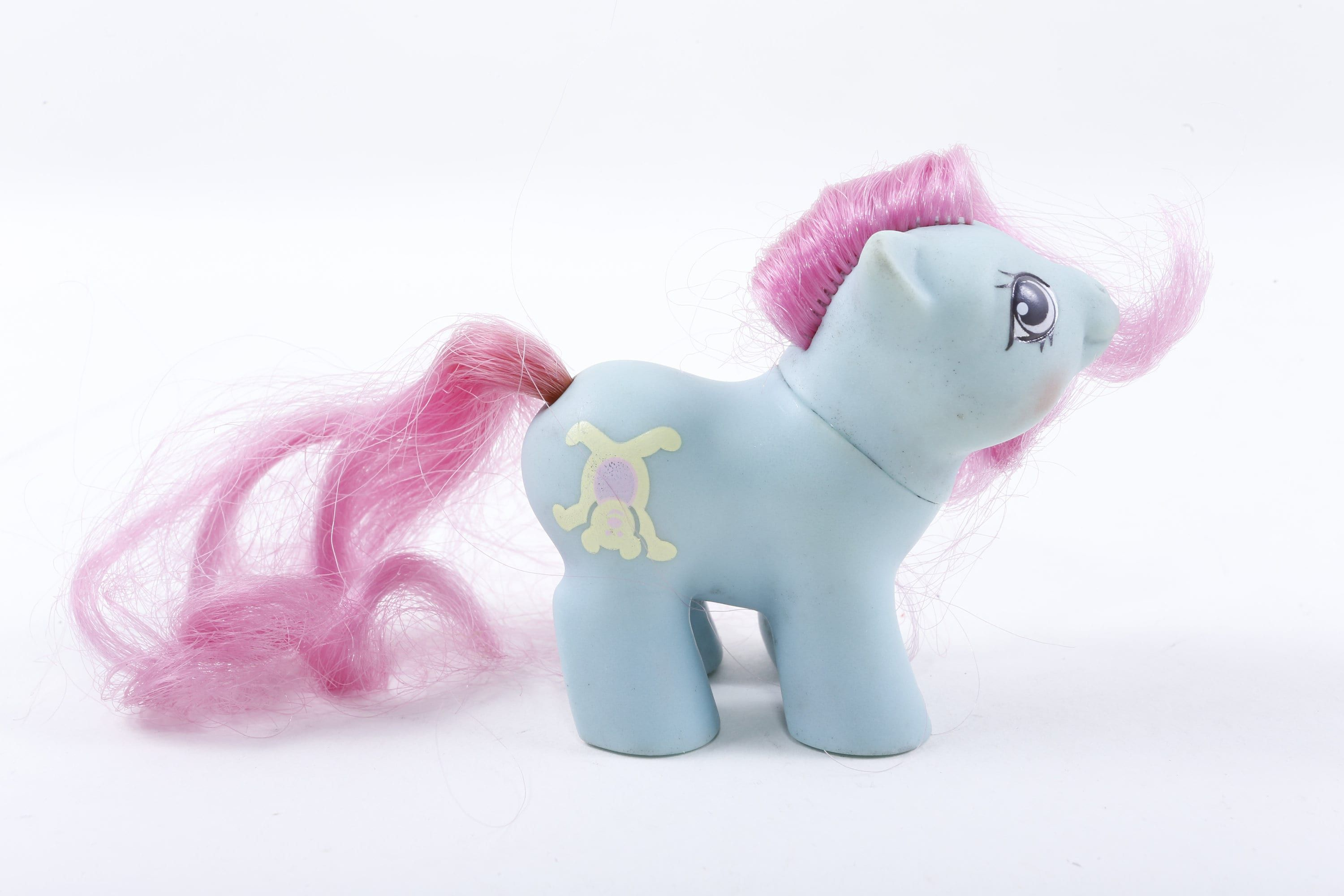 Vintage, Hasbro, My Little Pony, Newborn Shaggy, Blue Body, Pink Hair, Yellow Bear ~ 160921A Nice My Little Pony blue toy with white bear picture. By Hasbro. Some smoky smell to this pony. Great body shape. IMPORTANT INFO BELOW (Please Read For Fast & Helpful Answers to Common Questions) - Measurements: We try to include a ruler in each photo to show the measurement (in inches) for each item. If you can't find the measurements in the title, photos or description, go ahead and send a convo. -