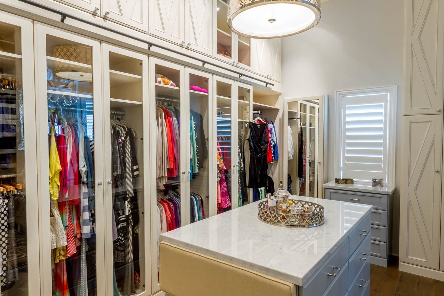 Combination Of Long And Double Hanging Sections Featuring Framed Glass Doors Accommodates Your Entire Wardrobe W Custom Closet Design Bedroom Closet Storage Closet Storage Systems