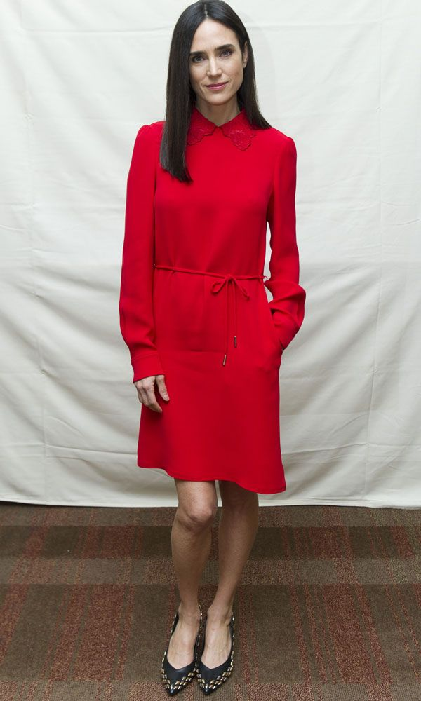 Jennifer Connelly looked as effortlessly chic as usual in a red shirt dress and pointed pumps at the Shelter photo call.