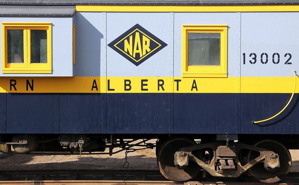 Caboose 13002 in a bright new paint job at Waterways, AB