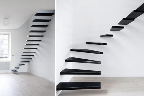 These steel floating stairs in Flat #1 by Ecole are simply amazing and a true statement of minimalism.