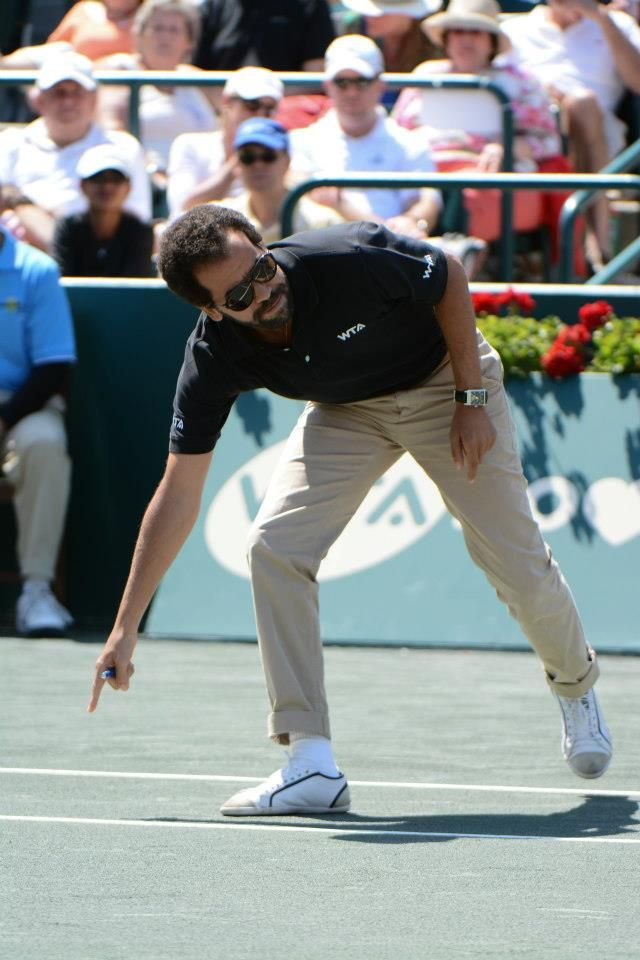 Chair Umpire Kader Nouni The Man With The Golden Voice Checks A Ball Mark During The Family Circle Cup Final B Jelena Jankovic Womens Tennis Billie Jean King