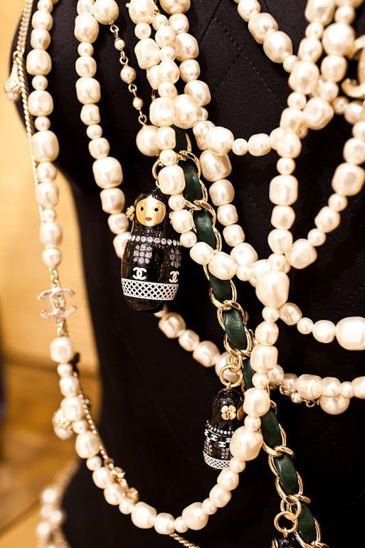 Chanel pearls with little Russian dolls and gold chains