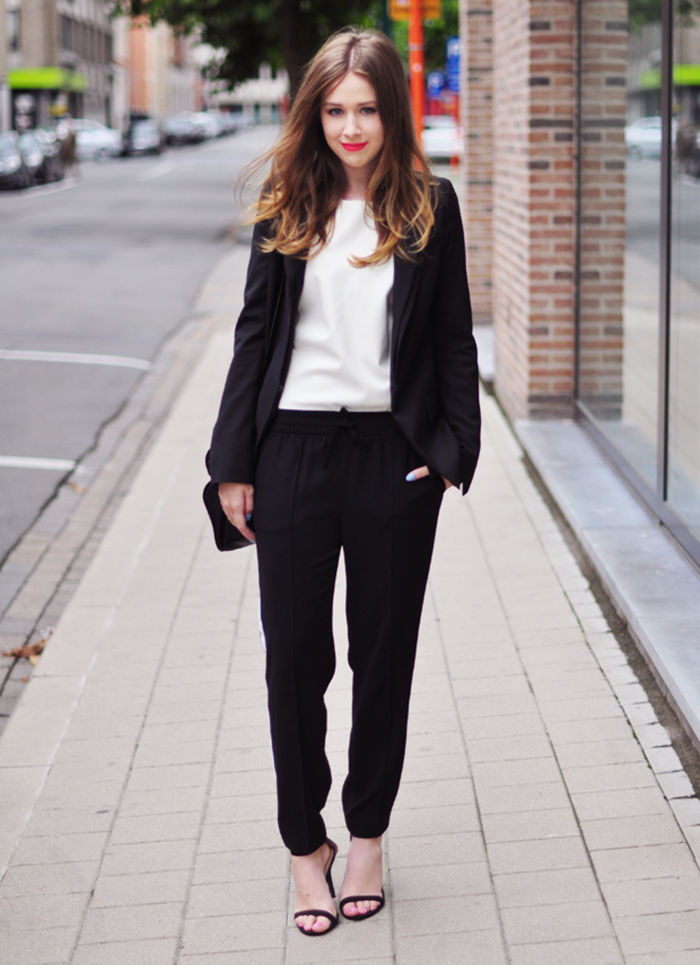 black trouser pant and jacket combo worn with strappy black heels and red lips