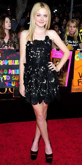 Dakota Fanning in a black laser-cut leather Valentino dress