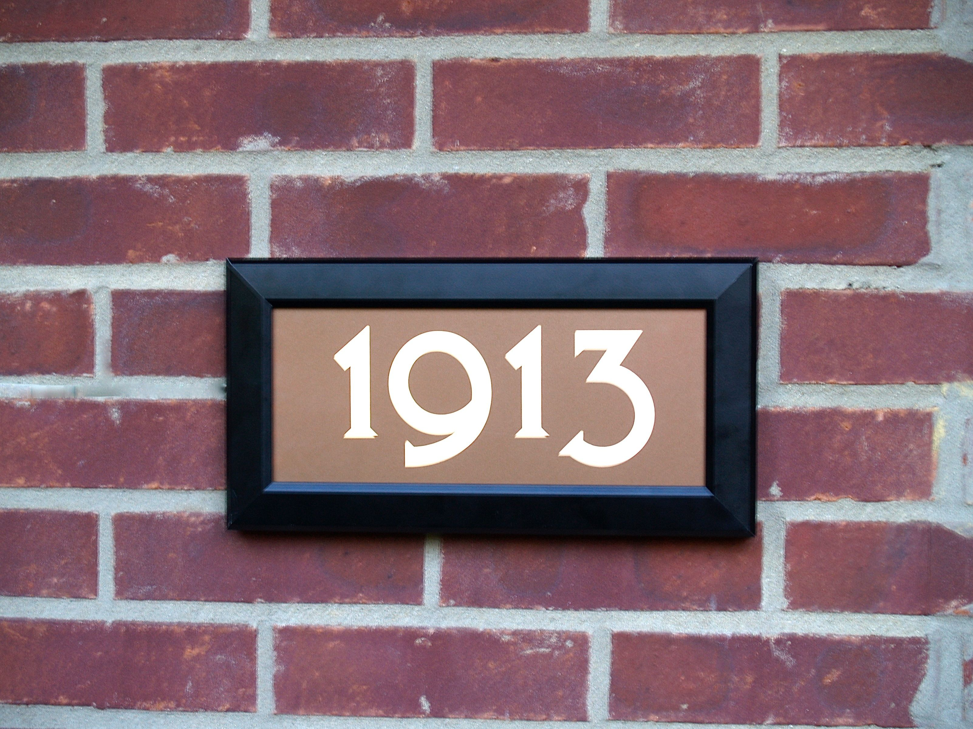 Address led lighted street signs can be mounted on a variety of exterior surfaces brick