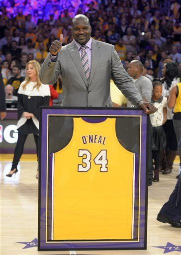 2da0b0f4d Shaquille O Neal stands with his retired jersey