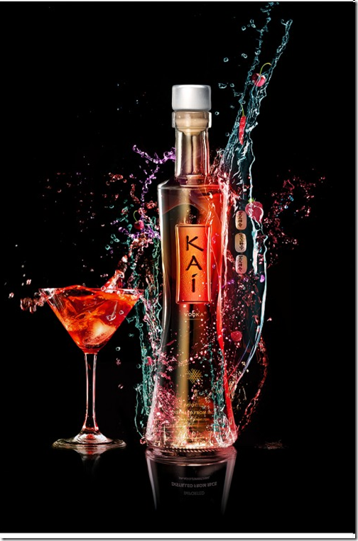 Composing Colorful water splash over alcohol bottle for advertising with Photoshop
