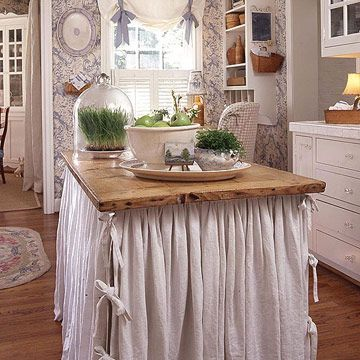 Turn an old table into a cottage-style kitchen island by adding a cloth skirt and storage underneath. You could even change the fabric for the changing seasons.  How fun would that be?