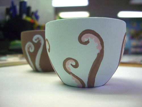 shaunasketches:    I have a set of six teacups (too small for tea… I may end up using them as candleholders) that will be getting an octopus makeover in the near future.