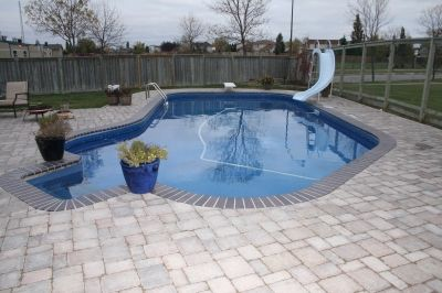 Gray brick coping pool landscape design swimming pool for Pool design hours