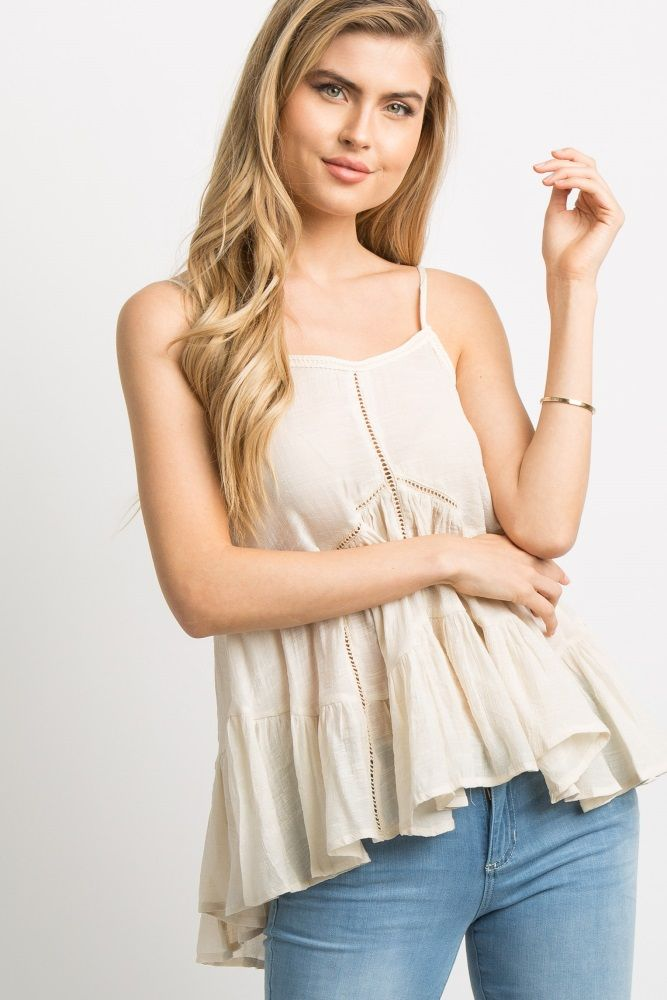 Pictures Of Womens Neckline Haircuts A Flowy Tiered Top Featuring A Solid Hue Adjustable Cami