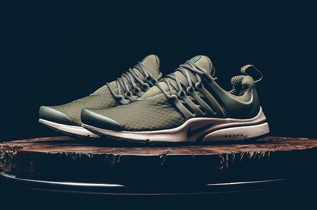 Nike Air Presto Essential Cargo Khaki. The Nike Air Presto Essential Cargo  Khaki features stretch mesh with Olive Green and Off-White.