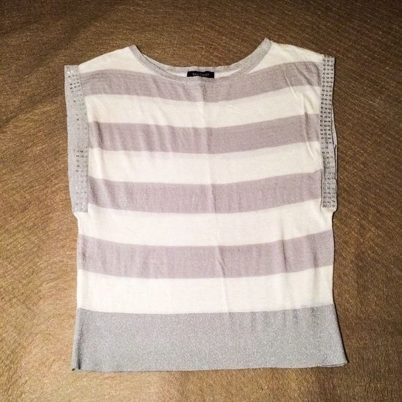 White House Black Market Sleeveless Top Brand new condition. Black House White Market Sleeveless Top. Size Medium. White & silver with sequenced sleeves and a subtle sparkle in the silver. Sleeves have built in armpit coverage. White House Black Market Tops Tank Tops